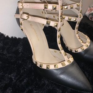 Black and beige studded heels